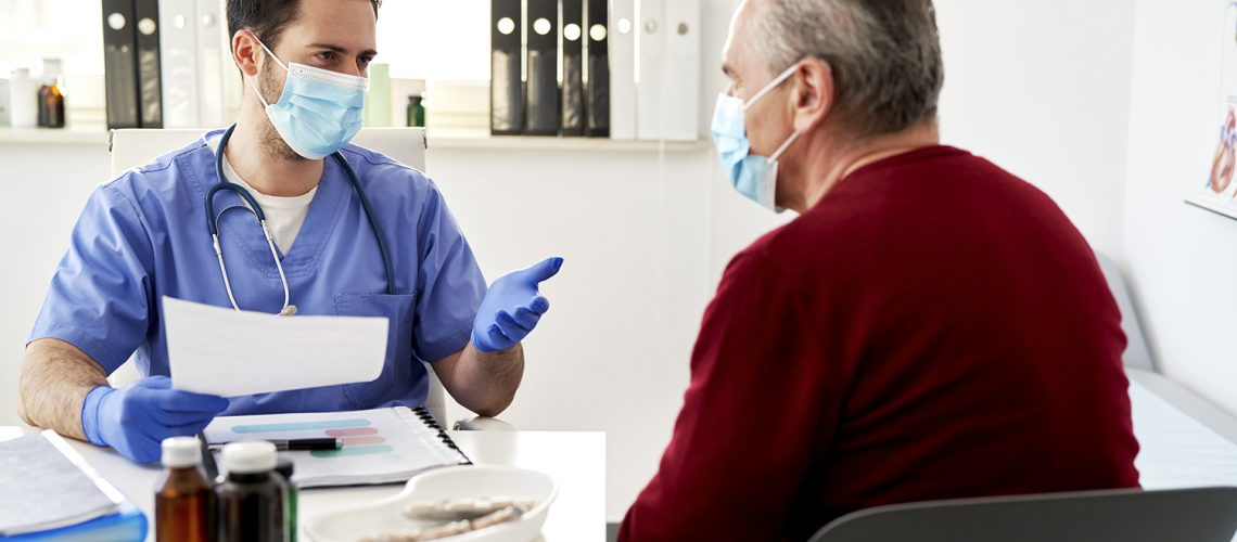 Doctor discusses the results of the elderly patient